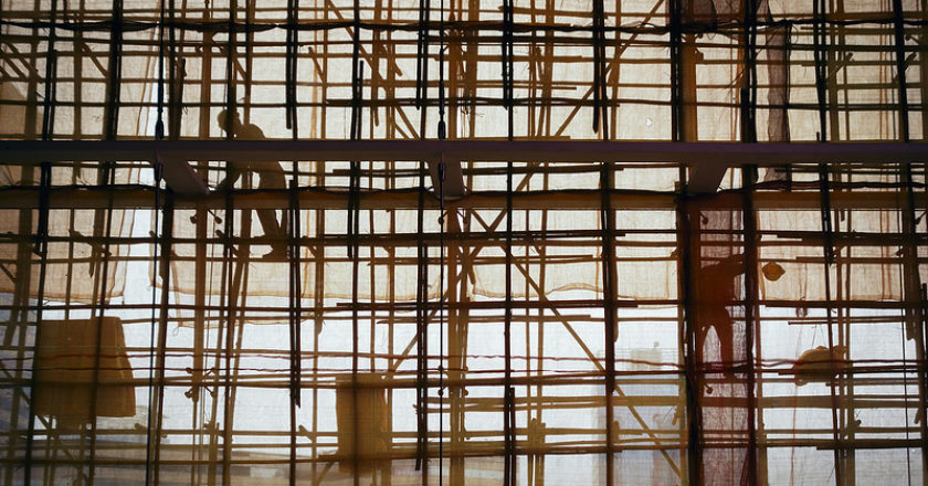 Construction workers on bamboo scaffolding