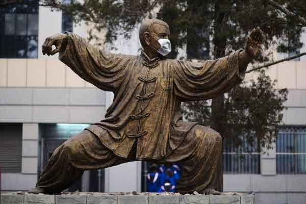Face Masks on Peking University Statues Protest Beijing Smog